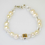 Our white freshwater pearl and crystal bracelet is a simple and thoughtful keepsake gift to give on a special baptism or christening day or communion day.