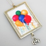 Celebrate a special birthday in personalized style with our Birthday Frame Photo Necklace. This fun necklace is the perfect gift to give to teens, young adults and even those fun girlfriends for a trendy style gift. Comes with a Love charm. Add a birth month dangle for an additional fee. The birth month dangle hangs with the Love Charm.