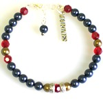 "Our US Marine Support Bracelet is a special way to keep a loved on near while serving our country. Made with swarovski pearls, crystals and silver toned beads. The bracelet is 7"" with an adjustable clasp and a sterling silver charm hangs near the toggle. Customize the bracelet with the birth month color of your loved one serving in the marines. Choose your special card."