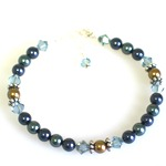 "Our US Navy Support Bracelet is a special way to keep a loved on near while serving our country. Made with swarovski pearls, crystals and silver toned beads. The bracelet is 7"" with an adjustable clasp and a sterling silver charm hangs near the toggle. Customize the bracelet with the birth month color of your loved one serving in the army. Choose your special card."