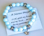 Give a special nurse a gift from the heart. Our Nurses Prayer Stretch glass bead bracelet is a thoughtful and keepsake gift idea. Easy to take on and off during a busy day. One size fits most. Blue toned beads. Nurse Prayer card.