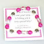 "Celebrate a special occasion or celebration with our pretty in pink Love and Wishes gift bracelet. Glass beads with silver toned beads sized for a young child/teen - 6 1/2""."