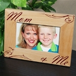 The bond a child has with Mom lasts a lifetime. The joy she brings into your life, the warm hugs and tasty goodies make Mom the best. Present your Mother with a Personalized Mom & Me Picture Frame as the perfect Mothers Day Gift she can enjoy every day. An attractive picture frame which simply compliments the your beautiful photograph.