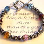 This elegant and simple style Mothers Bracelet is sure to touch the heart of any mom. Made with mostly Bali Silver and a touch of color out of Swarovski crystal, this bracelet casually highlights the birthstones of each child. The bracelet also works nicely as a grandmothers bracelet. Surprise mom this year with a Mothers Bracelet.