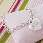"Give your Mom a designer look at an extraordinary price with our Moms Heavy Weight Charm Bracelet. Crafted of sturdy, sterling silver-plated links, this trendy bracelet is finished with a classic stand out heart charm engraved with ""Mom"". Perfect for holiday gift giving, especially Mothers Day, this gorgeous bracelet is something shell cherish for years! Includes a free organza gift pouch."