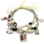 Show mom just how much you love her with this fun stretch charm bracelet. This four strand bracelet has a reversible photo charm (photos appear on both sides). instructions included. Let mom know just how charming she is.