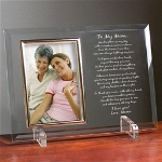 "Your Mom will love your personal sentiments & thoughtful picture beautifully presented in the Engraved Picture Frame. Our Personalized To My Mom Poem Beveled Glass Picture Frame is a heavy-weight glass with beveled edges on all sides, accented with golden brass frame trim. Frame measures 8"" x 11"" and holds your 4"" x 6"" photo; includes clear easel legs for top display. Engraved Mothers Day Keepsake includes FREE Personalization!"