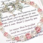 Show your mom just how important she has been and that you appreciate her love and guidance through the years. Here is a sentimental gift to give to the Mother of the Bride (or Groom) to wear during a wedding celebration. Abernook carries a variety of keepsake gifts for your bridal party including bridesmaid gifts, groomsmen gifts, flower girl and ring bearer gifts. The bracelet is made with pink and clear Swarvoski crystals, Bali silver beads, a silver toggle clasp and includes a dangle heart charm. The bracelet comes arrives in a box with a elegantly printed version of the poem.