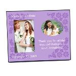 "What better way to thank mom for all the years of love and guidance that have helped you reach this special day. Personalize this frame with a childhood photo, the wedding date, and a special message for mom written by you. The small childhood photo will be printed on the frame itself above the message. This wooden frame features a glossy finish and holds a 4"" x 6"" photo. The frame measures 8"" x 10"" overall, and has a black back. Photo Submission: Email your photo to customerservice@moljewelry.com with your order number at the end of your transaction. Please submit your photo in portrait orientation. Personalization information: Personalize this gift with a special message for the selected recipient, a photo, and the date."