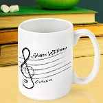 Ideal for an end-of-the-year gift for teachers, our sturdy white ceramic personalized teacher mugs provide that beloved teacher with a personalized container for their favorite hot drink. An attractive addition to any desk or ideal for use in the faculty lounge, these mugs feature a selection of 11 different designs, appropriate for a variety of subjects and grade levels. Its a gift that will warm her/his heart! Holds 15 ounces.