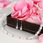 With its brilliant combination of glass pearls and Czech crystals, our Pearl & Crystal Jewelry Set will add just the right amount of dazzle. Whether youre looking to twinkle the night away at your Senior Prom or down the aisle at your wedding, let this amazing necklace and earring set be your perfect finishing touch. Great for brides, bridesmaids, flower girls, communion gifts or other religious gift occasions. Set includes pierced earrings and a matching necklace. Available in clear crystals with white or ivory pearls.