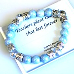 Celebrate a teacher graduation, end of year teacher gift or special celebration such as a retirement or holiday with our Stretched Designs Teachers Plant the Seeds gift bracelet.
