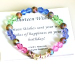 Celebrate a special thirteenth birthday with our colorful gift bracelet. A young teen is sure to feel special with this vibrant and sparkly keepsake gift bracelet. Made with glass beads, crystals and 13 silver beads.