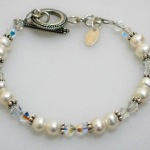 This swarovski crystal and silver bracelet is a perfect gift of encouragement. Celebrate a graduation, promotion, sweet 16, bat mitzvah or other celebration with the Shoot for the Moon Bracelet. A moon/star charm hangs by the toggle.