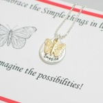 "Embrace the simple things in life... Card reads: Imagine the possibilities! silver beaded ball chain with lobster clasp. Matt silver toned ""imagine"" disc and butterfly charm. Approximately 18"""