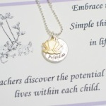 "Embrace the simple things in life... Card reads: Teachers discover the potential that lives within each child. silver beaded ball chain with lobster clasp. Matt silver toned ""potential"" disc and lotus flower charm. Approximately 18"""