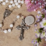 Whether its a Christening or First Communion, our charming religious faux pearl rosary will bring remembrances of that special day. Our lovely White Faux Pearl Rosary is rhodium-plated. Personalize your Rosary with any three initials. Rosary case sold seperately - Makes a great gift for any Godchild.