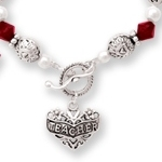 A teacher touches the life of a child. Celebrate and show your appreciation with a special gift idea for a holiday gift or end of year teacher gift. The gift bracelet also makes a special and keepsake gift for a graduation teacher.
