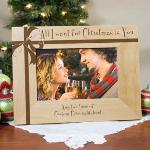 Celebrate the merry holiday season with a fun gift idea for your loved one. Our All I Want for Christmas wood photo frame can be personalized with two lines of a custom message.