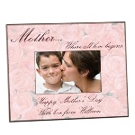 "A lovely wooden 8"" x 10"" frame is beautifully decorated with pink roses to provide the perfect setting for a 4"" x 6"" photograph of her favorite child that makes a great gift for Mother's Day. Better yet, you can add a special wish along the bottom underneath the photo so that she will have an especially fond memory of this day."
